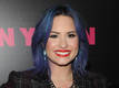 Demi Lovato praises mom for opening...