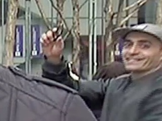Man waves gun behind TV reporter