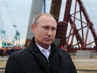 Putin says Russia won't enter arms race