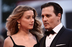 Amber Heard to donate entire divorce settlement