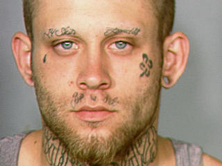 Judge: Man must cover swastika tattoo for trial
