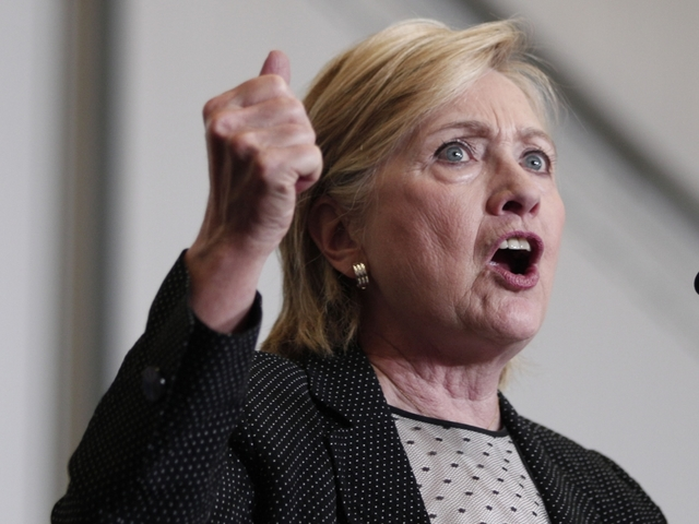 Clinton releases latest tax return, challenges Trump