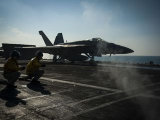 US says it's not working with Russia in Syria