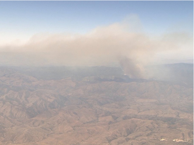 Firefighters battling 20 western wildfires
