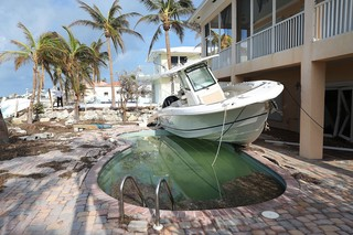 Who pays for Hurricane Irma and Harvey damages?