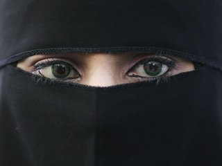 Quebec bans facial covers in some public places