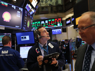 Dow hits milestone, rockets to 24,000