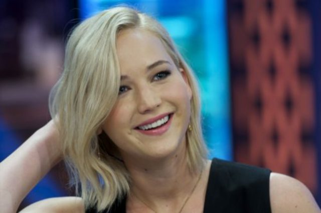 The art of distraction! Jennifer Lawrence is worlds away