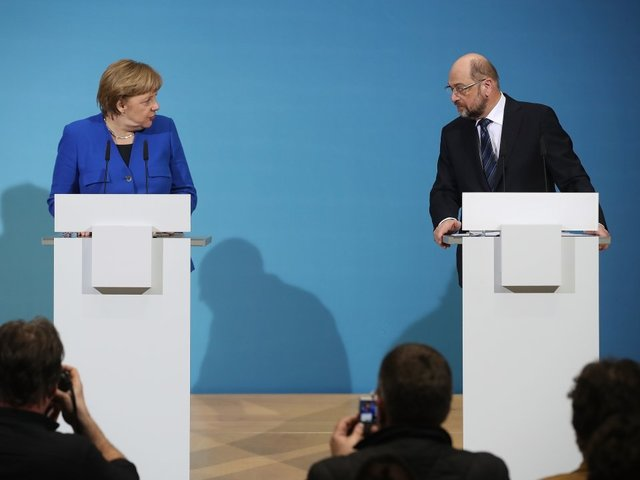 Germany' SPD narrowly backs coalition talks with Merkel