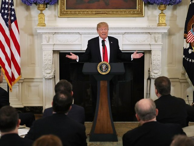 The Latest: On guns, Trump takes different tone about reform""