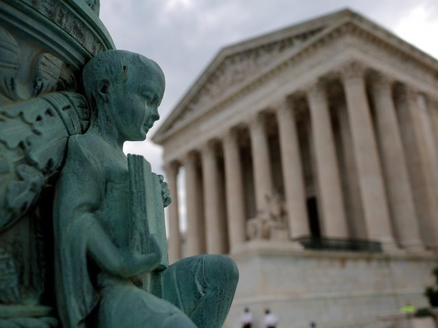 In travel ban case, Supreme Court considers
